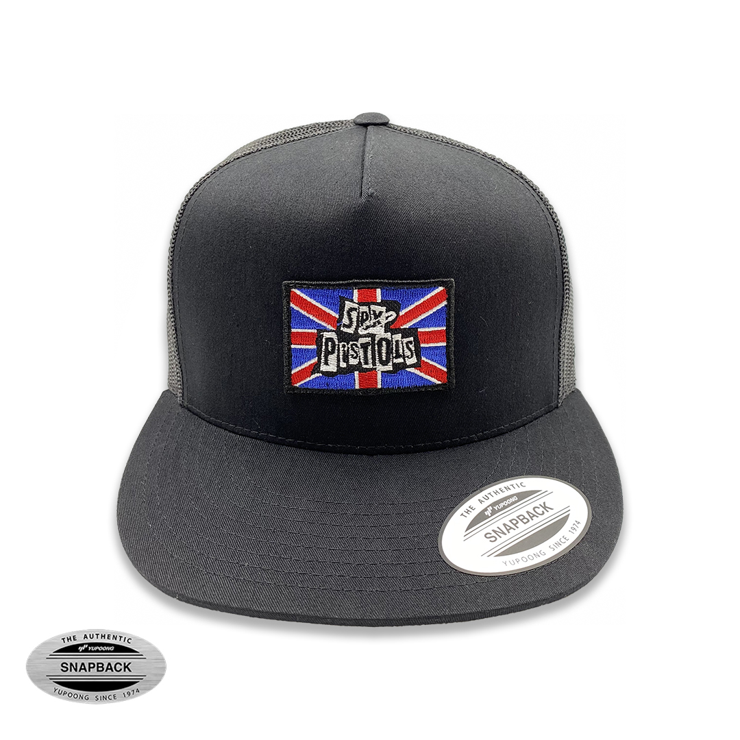 Sex Pistols TruckerFlexfit, gorro de la línea The classics, color negro con malla posterior y parche bordado frontal